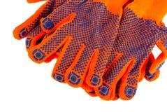 Viele bearbeiten den Handschuh, der auf weißem Hintergrund liegt Lizenzfreie Stockfotografie