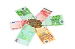 Viele Eurobanknoten und Münzen Lizenzfreie Stockfotografie