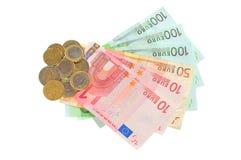 Viele Eurobanknoten und Münzen Lizenzfreies Stockbild