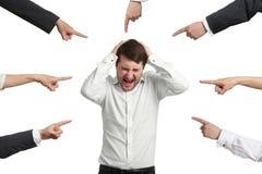 Viele Finger, die auf Mann zeigen Lizenzfreies Stockfoto