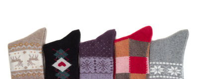 Viele gestrickte woolen Socken Stockfotografie