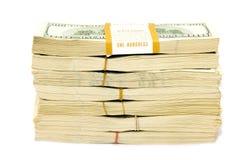 Viele großen paks der Dollar über Weiß ($70 000) Lizenzfreie Stockfotos