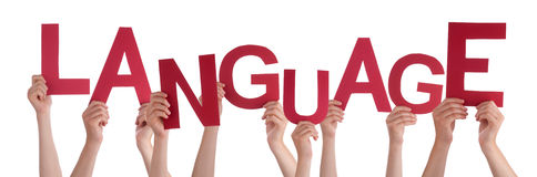 Viele Leute-Hände, die rote Wort-Sprache halten Lizenzfreie Stockfotos