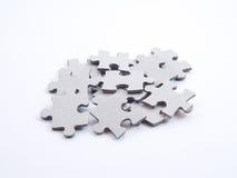 Viele grauen leeren Puzzel Stücke Lizenzfreies Stockbild