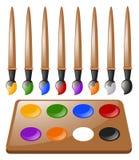 Viele Malerpinsel und Farbpalette Lizenzfreies Stockbild