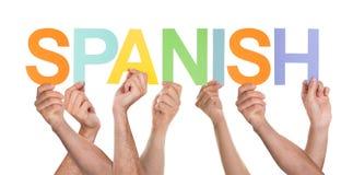 Viele Personen, die das Wort spanisch halten stockfoto