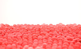 Viele roten Gelmarmore auf Weiß Lizenzfreies Stockbild