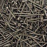 Viele schwarzen Spax-Schrauben Stockbilder