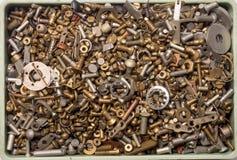 Viele verschiedenen Schrauben, Bolzen, Nüsse, Waschmaschinen, Hintergrund Lizenzfreie Stockfotografie
