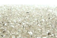 Viele weißen Gelmarmore auf Weiß stockfoto