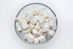 Viele weißen Stücke Zucker Lizenzfreie Stockfotografie