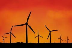 Viele Windmühlen als Schattenbild Stockbilder