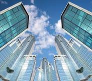Viele Wolkenkratzer auf Himmelhintergrund, Collage Stockbilder