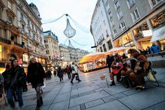 Vienna street with music,lights and sunset. Vien Austria winter royalty free stock images