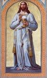 Viena - fresco de Jesus Christ como o padre por Karl von Blaas. do centavo 19. na nave da igreja de Altlerchenfelder imagens de stock royalty free