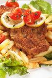 Viener schnitzel, breaded steak with french fries Royalty Free Stock Images