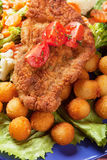 Viener schnitzel, breaded steak with healthy vegetables Stock Photo