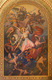Vienna - Archangel Michael and war with the bad angels scene by Leopold Kupelwieser from 1860 in nave of Altlerchenfelder church Stock Image