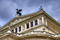 Vienna architecture. Exterior architecture of an ornate building with a winged horse statute on the roof located in Vienna, Austria Royalty Free Stock Photo