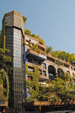 VIENNA – AUGUST 8: Facade of the Hundertwasser house with tree Stock Photos