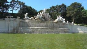 Fountain `Neptune` close-up, Sunny April day. Schonbrunn Park, Vienna, Austria. VIENNA, AUSTRIA - APRIL 28, 2018: Fountain `Neptune` close-up, Sunny April day stock footage