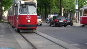 Retro tram on the city street. Vienna, Austria. VIENNA, AUSTRIA - APRIL 27, 2017: Retro tram on the city street stock footage