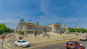 Vienna, Austria - 11 August, 2015: Beautiful facade and frontal view of parliament building with spectacular Royalty Free Stock Photo