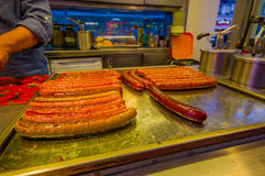 Vienna, Austria - 11 August, 2015: Closeup of classic Austrian bratwurst sausages lying on heated metal surface, display Stock Photo