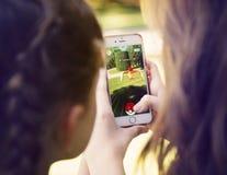 Vienna, AUSTRIA - August 1, 2016: Little girls playing a Pokemon Stock Photos