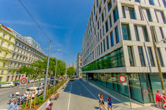 Vienna, Austria - 11 August, 2015: Street view on a beautiful sunny day, mixed old and new achitecture.  stock photos