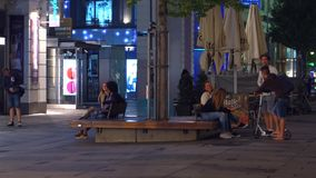 VIENNA, AUSTRIA - AUGUST 11, 2017. Young people hanging out in the city in the evening Royalty Free Stock Images