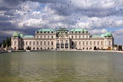 Vienna, Austria. Belvedere Palace building. The Old Town is a UNESCO World Heritage Site. Black birds over city royalty free stock images