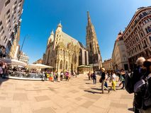 St. Stephen Cathedral in Vienna. VIENNA, AUSTRIA - CIRCA APRIL 2018: View on pedestrians as they pass by on the square front of the gothic building of the St stock image