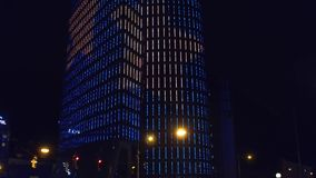 VIENNA, AUSTRIA - DECEMBER, 24 Beautiful illuminated high-rise building at night. 4K tilt video. VIENNA, AUSTRIA - DECEMBER, 24 Beautiful illuminated high-rise stock video footage