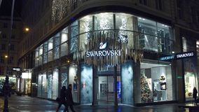 VIENNA, AUSTRIA - DECEMBER, 24 Big Swarovski store in the evening. Austrian producer of cut lead glass. VIENNA, AUSTRIA - DECEMBER, 24 Swarovski store in the stock photos