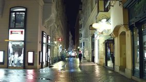 VIENNA, AUSTRIA - DECEMBER, 24 Christmas decorated narrow street in the evening. Touristic place with stores and cafes. VIENNA, AUSTRIA - DECEMBER, 24 Christmas stock image