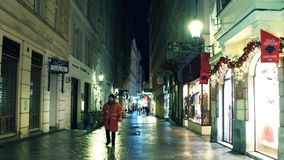 VIENNA, AUSTRIA - DECEMBER, 24 Christmas decorated pedestrian street in the evening. Touristic place with stores and. VIENNA, AUSTRIA - DECEMBER, 24 Christmas Stock Photography