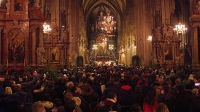 VIENNA, AUSTRIA - DECEMBER, 24 Christmas mass in Saint Stephen`s Cathedral. Popular touristic destination of the city. VIENNA, AUSTRIA - DECEMBER, 24 Christmas stock video