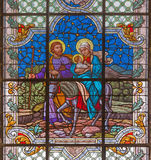 VIENNA, AUSTRIA - DECEMBER 19, 2016: The Flight to Egypt scene on the stained glass of church St. Laurenz. Schottenfelder Kirche by prof. Rudolf Geyling 1897 in Stock Photos