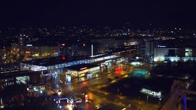 VIENNA, AUSTRIA - DECEMBER, 24 Illuminated urban railroad station and moving trains at night, aerial view. 4K video. VIENNA, AUSTRIA - DECEMBER, 24 Illuminated stock footage