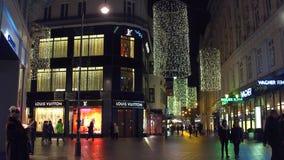VIENNA, AUSTRIA - DECEMBER, 24 Louis Vuitton and Rolex luxury stores in the evening Stock Photos