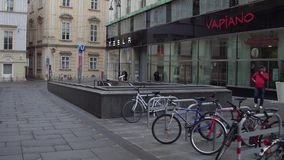 VIENNA, AUSTRIA - DECEMBER, 24 Parked bicycles, metro station entrance and Tesla electric cars showroom. Ecologic Royalty Free Stock Photos