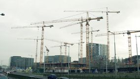 VIENNA, AUSTRIA - DECEMBER, 24 Steadicam shot of cranes at big construction site of The Icon luxury buildings in city. Center. 4K clip stock video footage