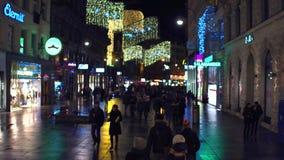 VIENNA, AUSTRIA - DECEMBER, 24, 2016 Steadicam shot of defocused Christmas decorated pedestrian street in the evening