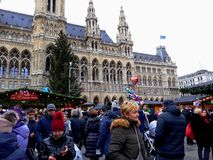 Tall gothic building of Vienna city hall Rathaus and traditional Christmas market. Vienna, Austria - December 16, 2017: Tall gothic building of Vienna city hall Royalty Free Stock Photo