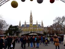 Tall gothic building of Vienna city hall Rathaus and traditional Christmas market. Vienna, Austria - December 16, 2017: Tall gothic building of Vienna city hall Royalty Free Stock Images