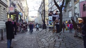 VIENNA, AUSTRIA - DECEMBER, 24, 2016 Tourists making photos and selfies near famous expressionist Hundertwasser House Royalty Free Stock Photo