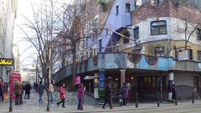 VIENNA, AUSTRIA - DECEMBER, 24 Tourists taking photos near famous expressionist Hundertwasser House Stock Photos
