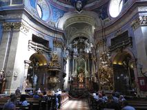 Vienna, Austria-29.07.2018: interior of St. Peter Peterskirche Church, Baroque Roman Catholic parish Church in Vienna, Austria. Inspired by St. Peter`s stock photos