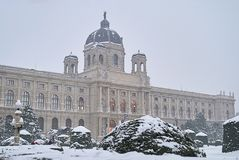 Natural History Museum in Vienna in foggy morning after snowfall. Everything aroun museum is covered by snow after strong snowfall royalty free stock photos